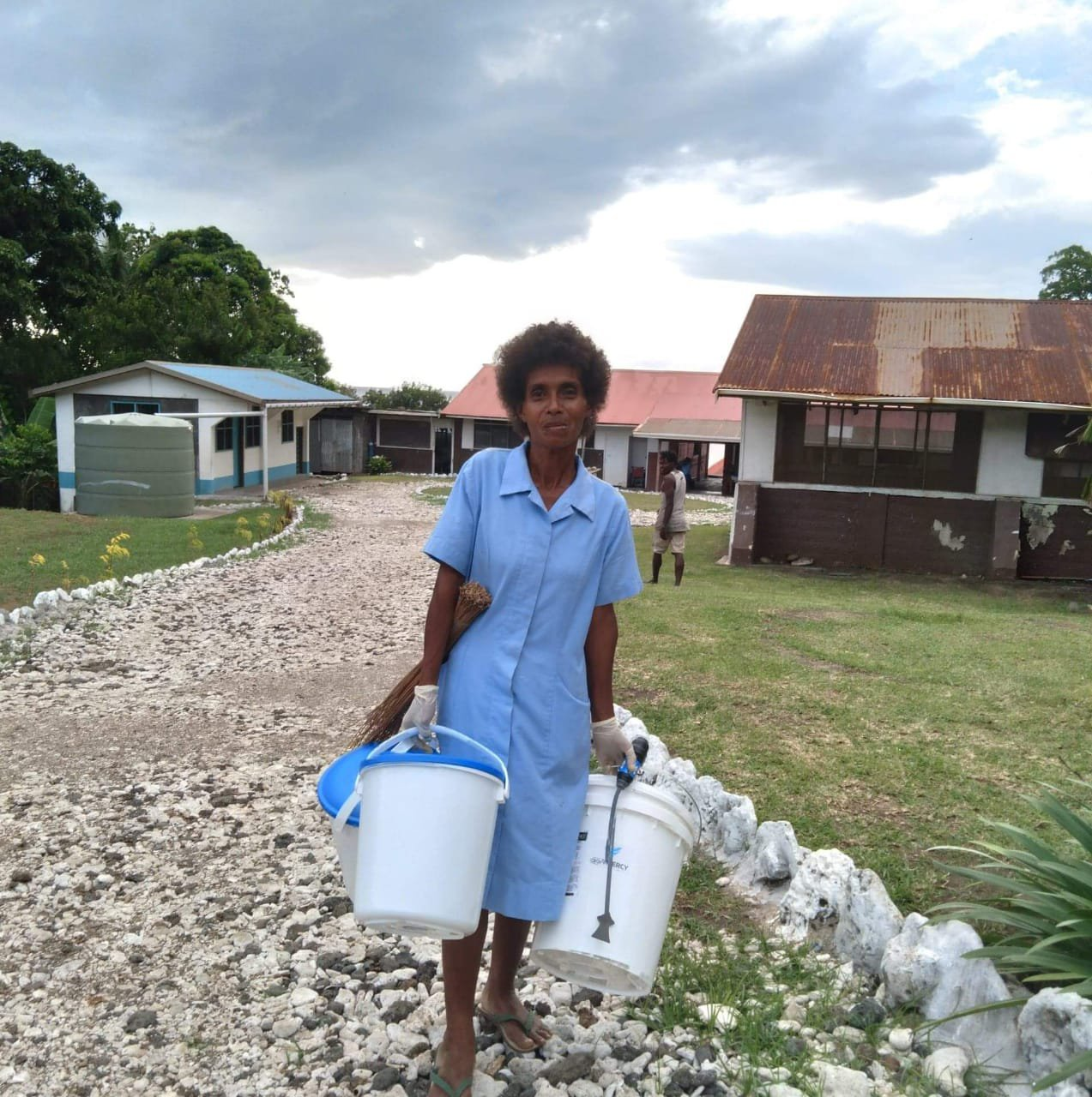 A village nurse receiving a filter and bucket set in Ambae.jpeg